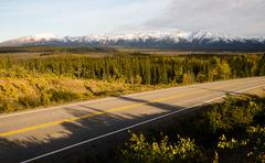 Highway Passes Through Changing Colors Alaska Mountains Autumn Season - stock photo