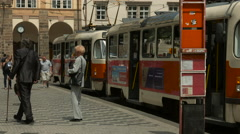 Tram closing the doors and leaving the tram station in Prague - stock footage