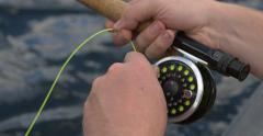 4k Close up of fly fishing rod reeling in Stock Footage