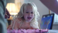 Girl Watching Cupcake Decorating - stock footage