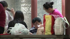 Chinese family playing cards in Beijing park Arkistovideo