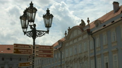 Street indicators on an old lamp post in Prague Stock Footage