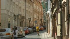 Riding bike and walking on Nerudova Street, Prague Stock Footage