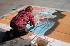 ephemeral artist painter in the street of Paris - stock photo
