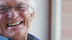 4K Close up portrait of elderly man laughing - stock footage