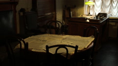 Table with newspapers in an antique Soviet apartment in Russia Stock Footage