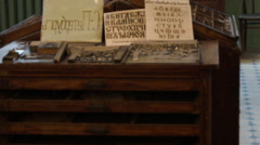 Typesetting composting stick at a vintage Soviet printing press Stock Footage