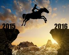 The rider on the horse jumping into the New Year 2016 Stock Photos