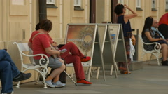 Tourists sitting on benches at Prague Castle Stock Footage