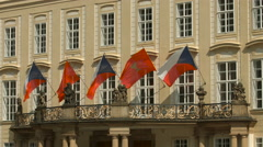 Flags waving on the Prague Castle Archives building Stock Footage
