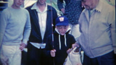 1954: Kid shows off fishing catch of halibut with grandpa, brothers and family. Stock Footage