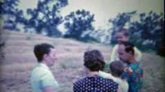 1954: Family converses while creepy redhead girl stares at camera. Stock Footage