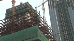 Skyscraper construction with cranes, China - stock footage