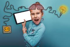 adolescence baby girl points to the tablet and screaming rage ch - stock photo
