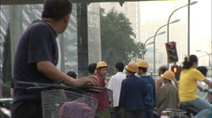 Chinese construction workers at crosswalk - stock footage