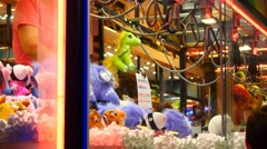 Stock Video Footage of 4k funfair celebration christmas party claw catcher machine