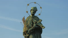 The old statue of St John of Nepomuk on Charles Bridge, Prague Stock Footage