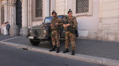 Italian soldiers stand guard in Piazza Navona, Rome, Italy. Stock Footage