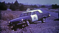 1964: Crashed cop car needs a tow from roadside ditch after police chase gone Stock Footage