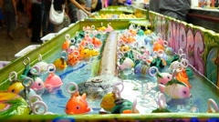 4k funfair celebration christmas party rubber ducks floating catch game Stock Footage