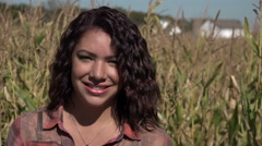 Portrait of a young woman standing in a cornfield Stock Footage