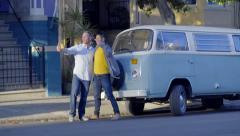 Guys Pose For Road Trip Selfies In Front Of Camper Van Stock Footage