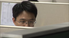 Close-up of male Chinese office worker - stock footage