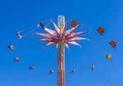 A chair swing ride shot in blue sky - stock photo