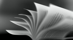 Book slow motion repeatly move over black background - stock footage