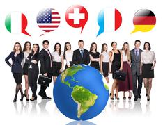 Business people near big earth and flag bubbles - stock photo