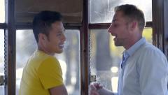 Gay Couple Ride Street Car In San Francisco, Look Out Window Together And Chat Stock Footage