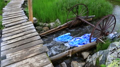 Adaptation for washing linen in a mountain river - stock footage