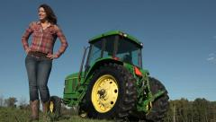 Portrait of a female farmer with her tractor Stock Footage