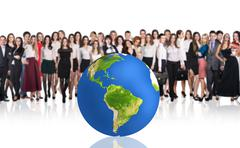 Successful businesspeople beside big earth ball. - stock photo