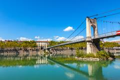 Old Passerelle du College bridge over Rhone river in Lyon, France Stock Photos