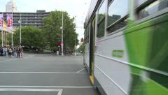 City street with pedestrians cars & trams (Timelapse) Stock Footage