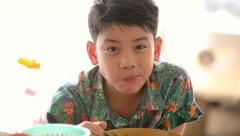 Happy asian kid eating noodles,smile face - stock footage