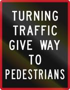 Old version of New Zealand road sign - Turning traffic give way to pedestrian - stock illustration