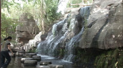 Waterfall with stepping stones, China Stock Footage
