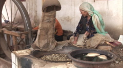 Uyghur woman spinning silk, Xinjiang, China Stock Footage