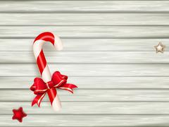Candy cane on wooden board. EPS 10 - stock illustration