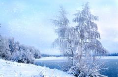Winter landscape with trees, covered with hoarfrost and lake vie - stock photo