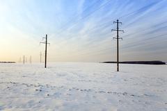 winter field  , sunset - stock photo