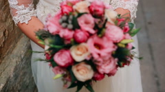 Bride with bouquet, closeup Stock Footage