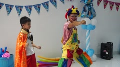 The clown with the kids for the weekend - stock footage