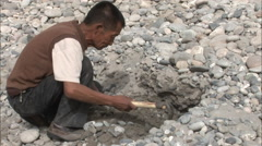 Man digging for jade, Xinjiang, China - stock footage