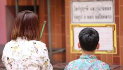 Asian mother and son are spends time praying - stock footage
