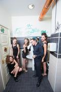 man in toilet with drunk women - stock photo