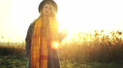 Romantic girl in a field in sunset light. winter, autumn life Stock Footage
