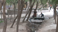 Woman fetches water, Kashgar, China Stock Footage